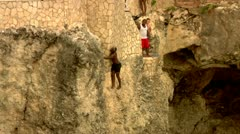 Rock Climbing out of Lagoon Stock Footage