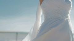 Girl in white dress walks closer Stock Footage