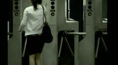 Subway entrance turnstile passenger enters Stock Footage