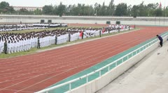 pan China Chinese college students field huge unified marching assembly drills - stock footage
