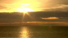 Yellow Orange Evacuating Sun Time lapse Ocean Stock Footage