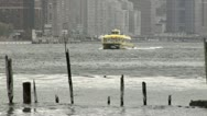 Stock Video Footage of New York Water Taxi Distant Arriving Dock
