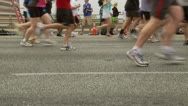 Stock Video Footage of Closeup of Runners' Shoes During 10K Race 1