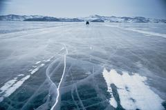winter ice road through baikal - stock photo