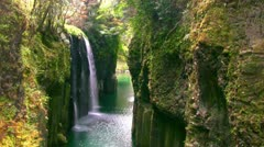 Rocks and spring waterfall Stock Footage