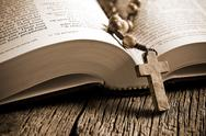 Stock Photo of wooden rosary on the open bible