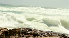 Waves crushing and rolling over rocks at coastline Stock Footage