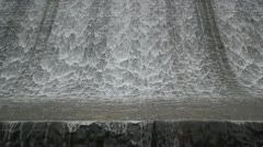 Still China Chinese calm wall of water flowing down stone old dam Stock Footage