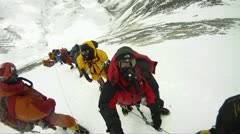 Big line of climbers on Mt. Everest waiting and resting Stock Footage