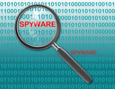 close up of magnifying glass on spyware - stock illustration