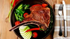 Savory : roasted beef spare rib on dark dish with pepper and tom Stock Footage