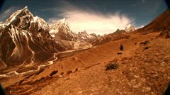 Wide shot of trekker near Dukla on Mt. Everest. Stock Footage