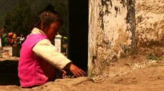Little nepalese girl playing with stone in Kathmandu Nepal. Stock Footage
