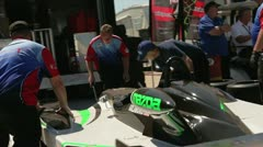Mechanics are fixing the racing car - stock footage