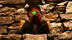 Nepalese boy pretending to take photos with toy Stock Footage