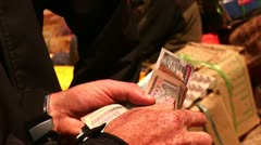 Counting money to give to vendor in a Himalayan market. Stock Footage