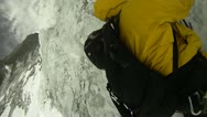 Stock Video Footage of Close-up of climbers crampons in ice
