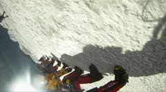 Sweeping shot of line up of climbers Stock Footage