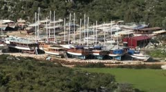 Boats on hard standing zoom out Stock Footage
