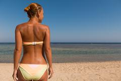 Slim sensuous woman looking at the sea - stock photo