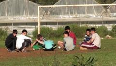 Children take rest at football field Stock Footage