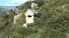 Lycian Tomb in Simena zoom in Stock Footage