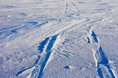snowdrift and tire tracks - stock photo