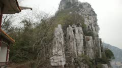 Pan Guilin China Chinese beautiful mountain top looking down on city Stock Footage
