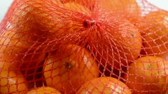 Clementines in net Stock Footage