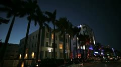 Night P.O.V. driving by Art Deco hotels on Ocean Drive, Miami  - stock footage