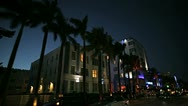 Stock Video Footage of Night P.O.V. driving by Art Deco hotels on Ocean Drive, Miami