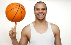 Spinning Basketball on Finger - stock photo