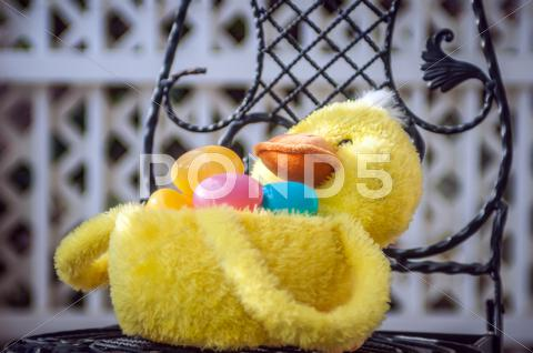 Stock photo of easter duck basket
