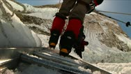 Stock Video Footage of Close-up of crampons on ladder rungs