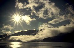 Sunburst with fog - stock photo