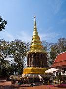 golden pagoda, wat phrathat chomkitti temple in chiang rai, thailand. - stock photo
