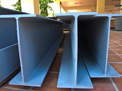 row of corroded steel i-beams poles - stock photo