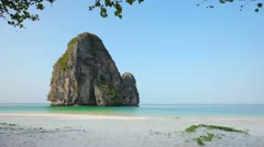 Tropical beach with rock in the water, railay, thailand Stock Footage