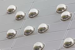 cityscape reflection in metal sphere facade detail - stock photo