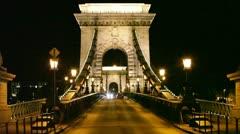 Night traffic of cars on Secheni Bridge through Danube in Budapest Stock Footage