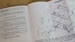 Paper sheets of technical manual, with text and charts Stock Footage