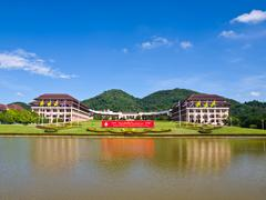 entrance view of mae fah luang university, chiang rai, thailand - stock photo