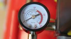 Air compressor industrial pressure gauge, rack focus Stock Footage