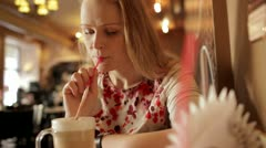 Portrait of girl enjoying coffee latte in cafe. Stock Footage