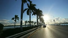 P.O.V. driving Miami city causeway at sunset, Florida, USA Stock Footage