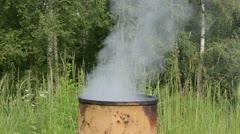 Smoke rise retro rusty barrel smoke house Stock Footage