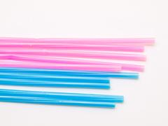 Stock Photo of light blue and pink straws isolated on white back ground