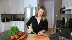 Woman Slicing Carrots Stock Footage
