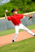 Youth ball player throwing ball Stock Photos