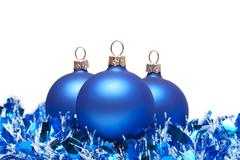 Blue christmas balls with tinsel isolated on white Stock Photos